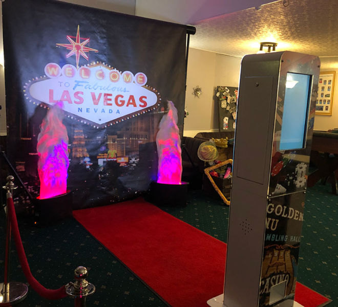 Selfie pod and backdrop at a Vegas theme party