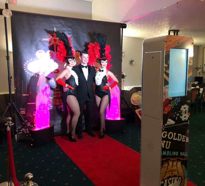 Our Vegas theme selfie pod with backdrop and showgirls