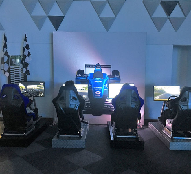 4 racing simulators and Race Car Backdrop