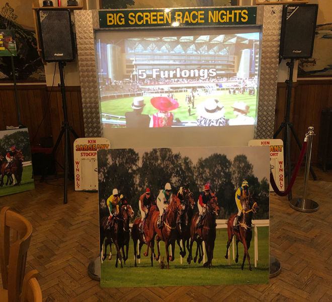 Big screen race night with our theming