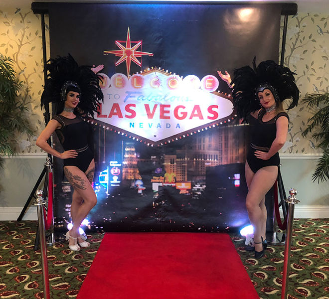 Vegas backdrop and showgirls at Gisbrough Hall Yorkshire