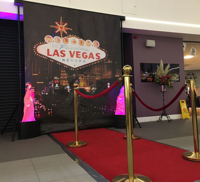 Vegas backdrop red carpet with post and ropes