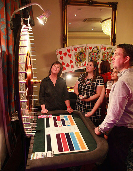 Card arch prop and wheel of fortune at a fun casino event at Hardwick Hall Sedgfield Co Durham